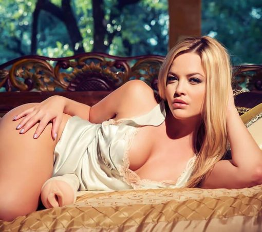 Alexas Texas on a couch with her fleshlight