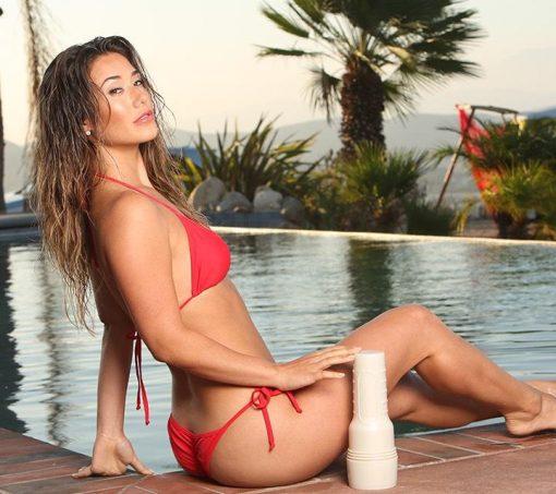 Eva Lovia sitting by a pool with her fleshlight
