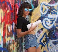 Janice Griffith standing against wall with fleshlight